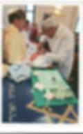 טקס ברית מילה שנערך בידי המוהל הרופא דוקטור שקולניק A circumcision ceremony conducted by a mohel physician Dr. Zvi Shkolnik
