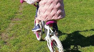 Sophia riding her bike