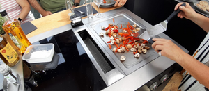 The Bora Classic extractor sits alongside an induction hob and a stainless steel teppanyaki