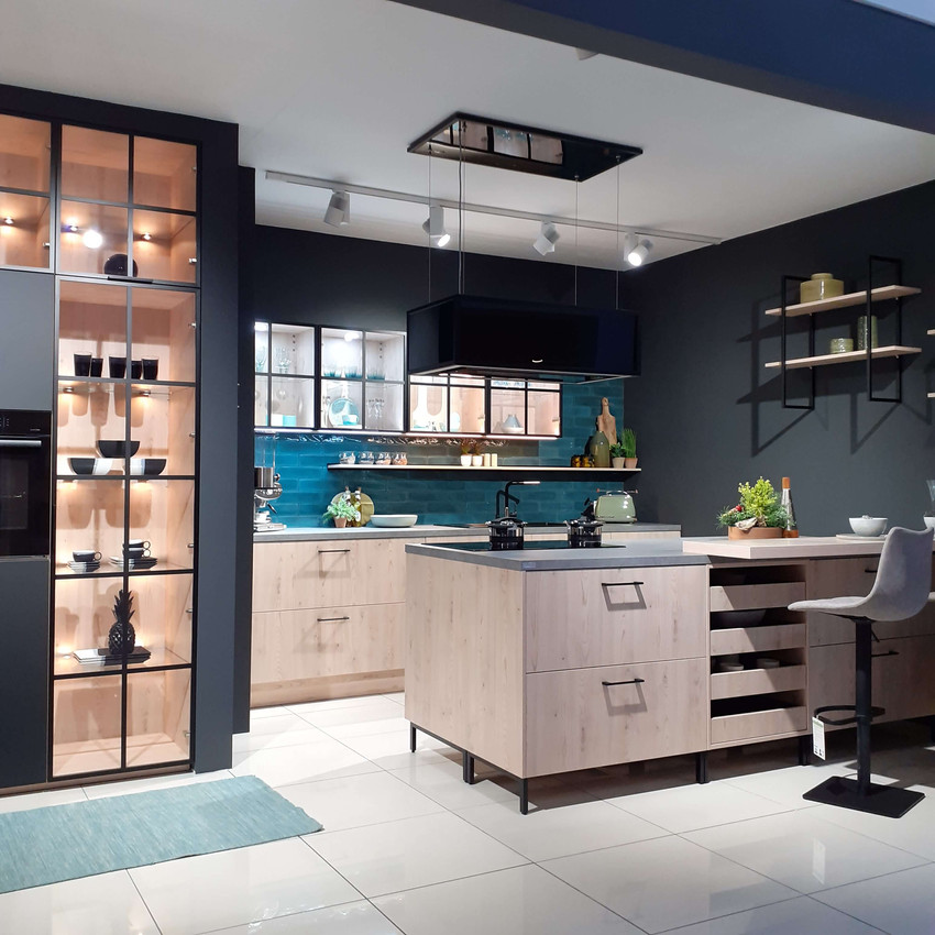 Industrial look kitchen with oak units and black metal glazed fronted units