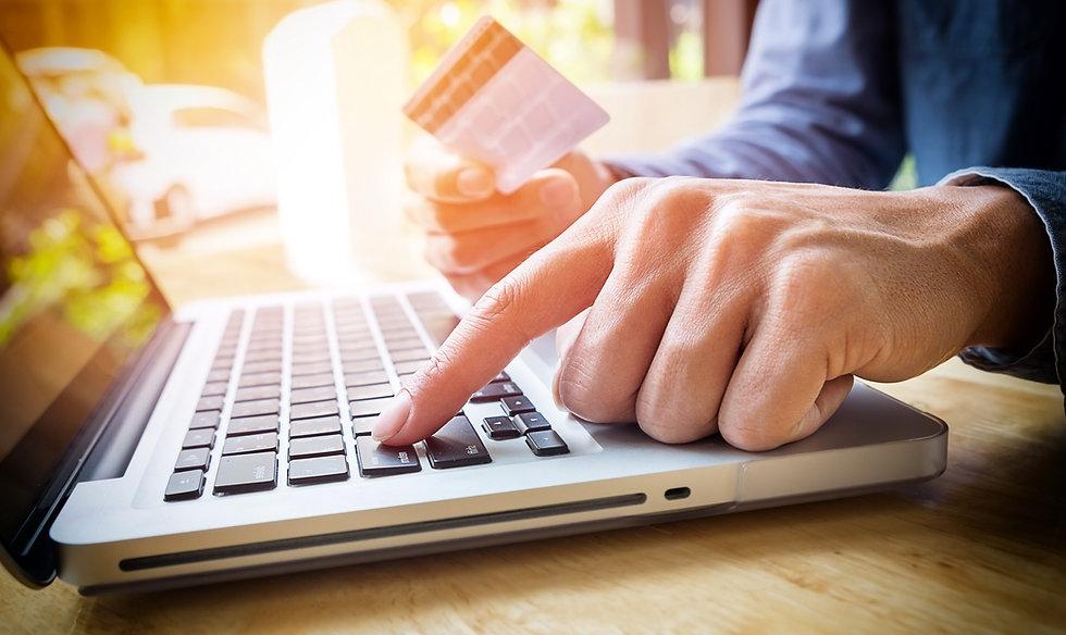 man-holding-credit-card-hand-entering-se