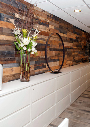 Pallet Wood Wall With White Drawers