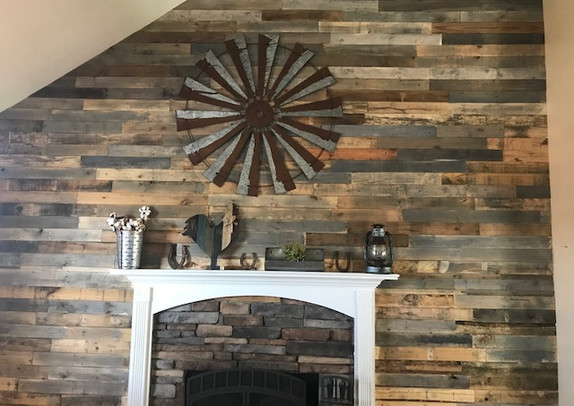 Pallet Wood Wall Surrounding The Fireplace
