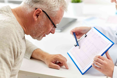 doctor-showing-cardiogram-to-old-man-at-