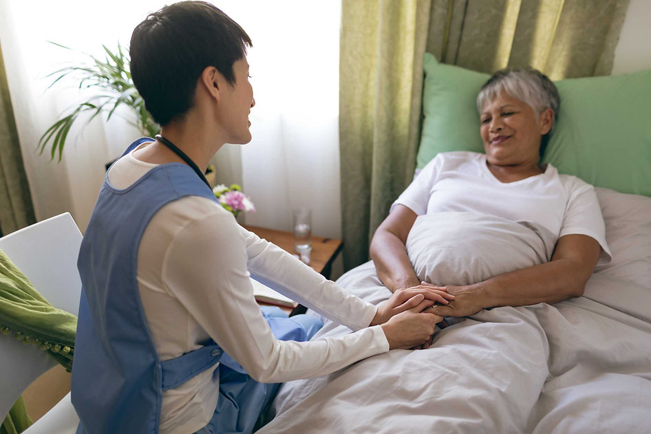 female-nurse-taking-care-of-senior-femal