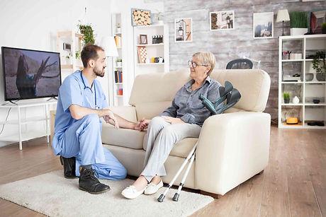 male-care-taker-in-a-nursing-home-holdin
