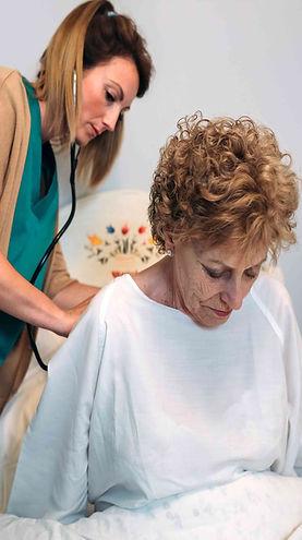 caregiver-auscultating-senior-woman-HFVK
