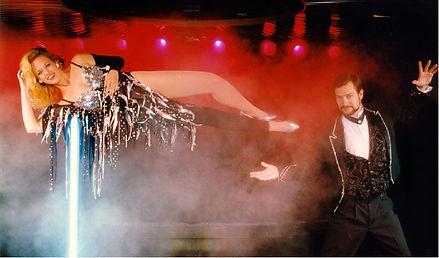 Larry Volz magician levitating a woman