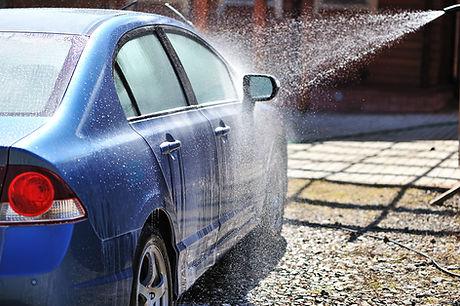 Bright blue car at carwash
