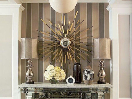 The wallpaper is the background for this mixed metal story board.  The silver lamps and shades shine