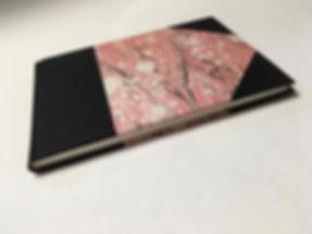A sketchbook with marbled paper cover by la Carta di Arielle Benozio