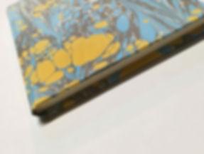 A marbled paper notebook handmade by la Carta di Arielle Benozio in Florence
