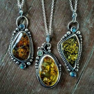trio of amber pendants.jpg