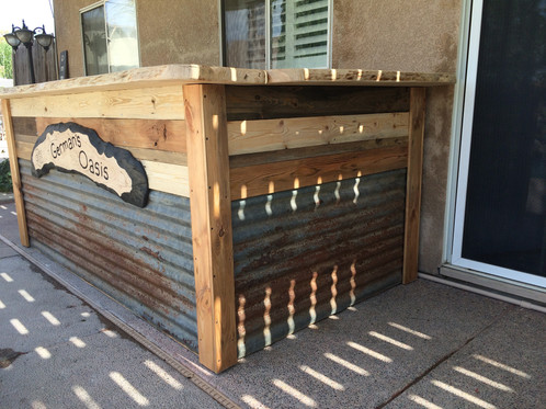 These Outdoor Patio Bar S Feature Standard 2 X 4 Construction On The Inside Thick Wood Slab Tops And Reclaimed Sheet Metal Cladding