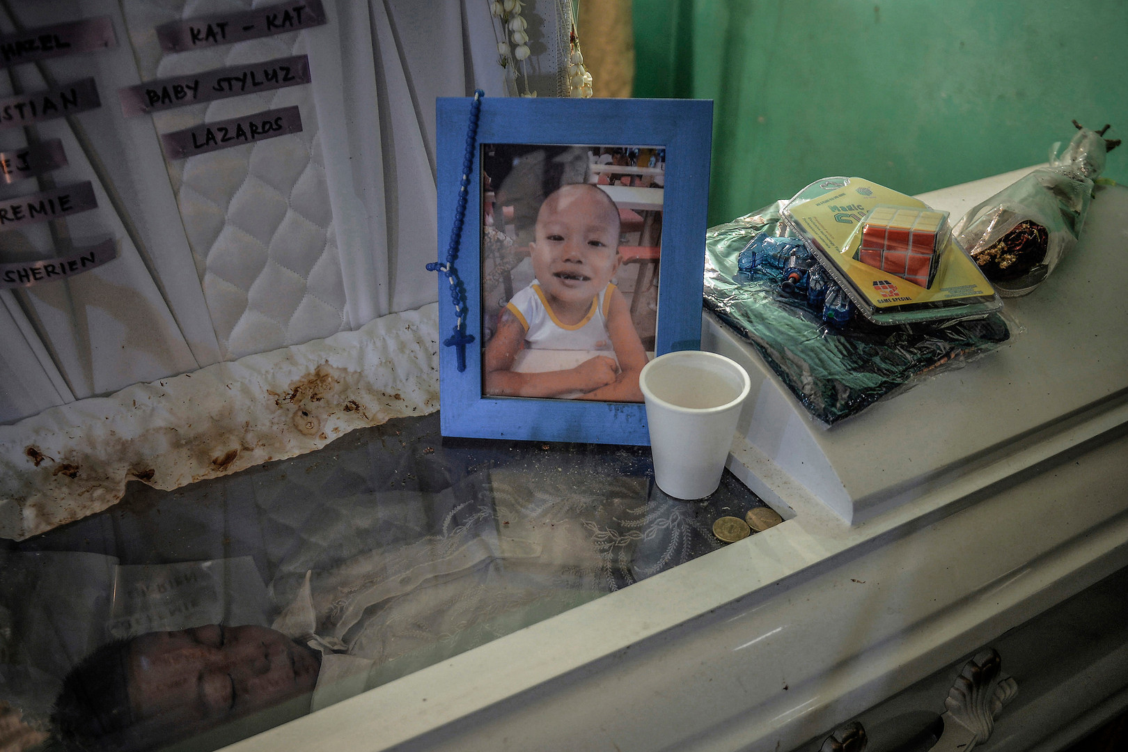 The body of 5-year-old Francis Manosca lies in a coffin during his funeral wake in Pasay, Philippines, December 20, 2016. Domingo Manosca and his 5-year-old son Francis was in their Pasay home when a gunman knocked on their door. Domingo stood up and peeped through a hole in the wall, the gunmen opened fire hitting him and his child Francis who was standing behind him. Domingo died on the spot while Francis passed away while being treated at the hospital.