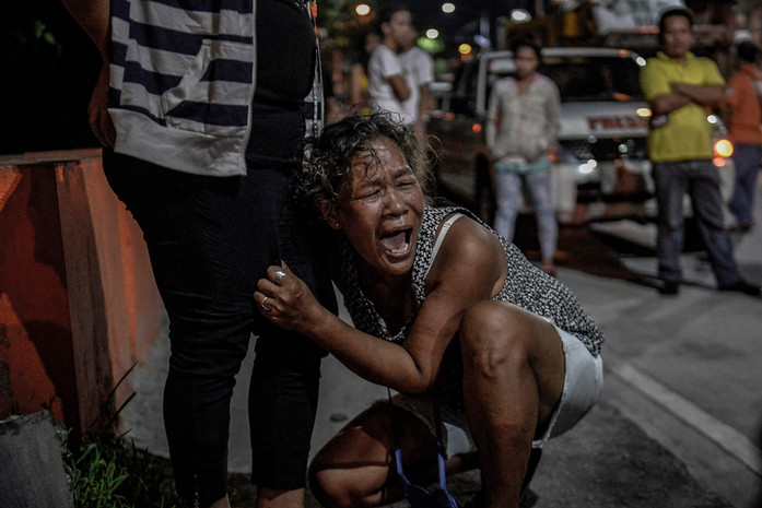 Isabelita Espinosa weeps outside a funeral parlour following the death of her 16-year-old son Sonny and six other people after armed men opened fire on two shanties in North Caloocan, Metro Manila, Philippines, December 28, 2016. According to police and residents, their supposed target was a known drug personality. The fatalities included three minors and a pregnant woman.