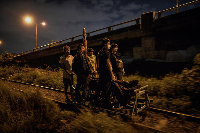 The bodies of Paul Lester Lorenzo and Danny Laurente are hauled away in a makeshift trolley along a railroad, after they were shot dead by police in what they say was a drug buy-bust operation in Manila, Philippines, August 17, 2016. The two men had allegedly fought back.