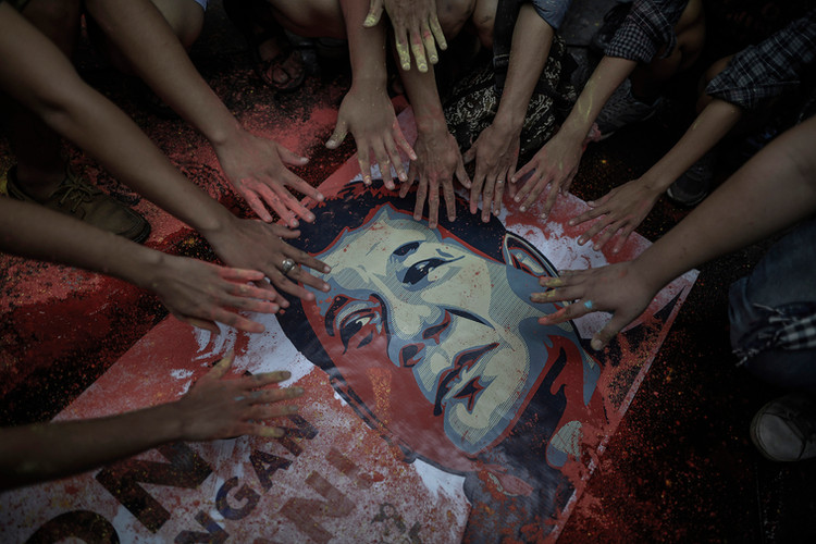 Supporters stretch their hands towards a portrait of Philippine President Rodrigo Duterte during a welcome rally outside Malacañang Palace in Manila, Philippines on June 30, 2016—his inauguration day.