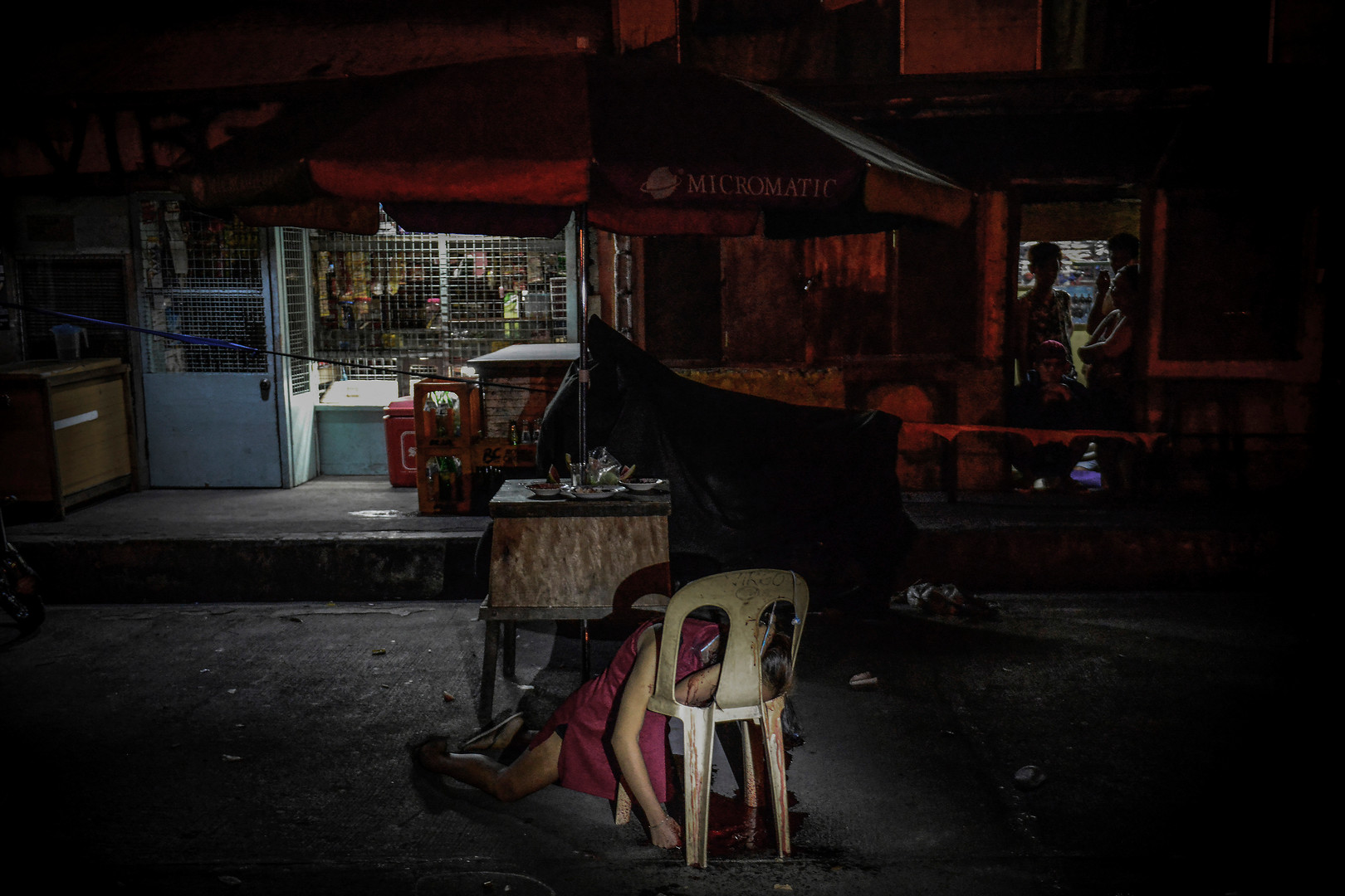 The body of Kristita Padual is slumped on a chair after she was shot dead by unknown assailants in Quezon city, March 4, 2017.