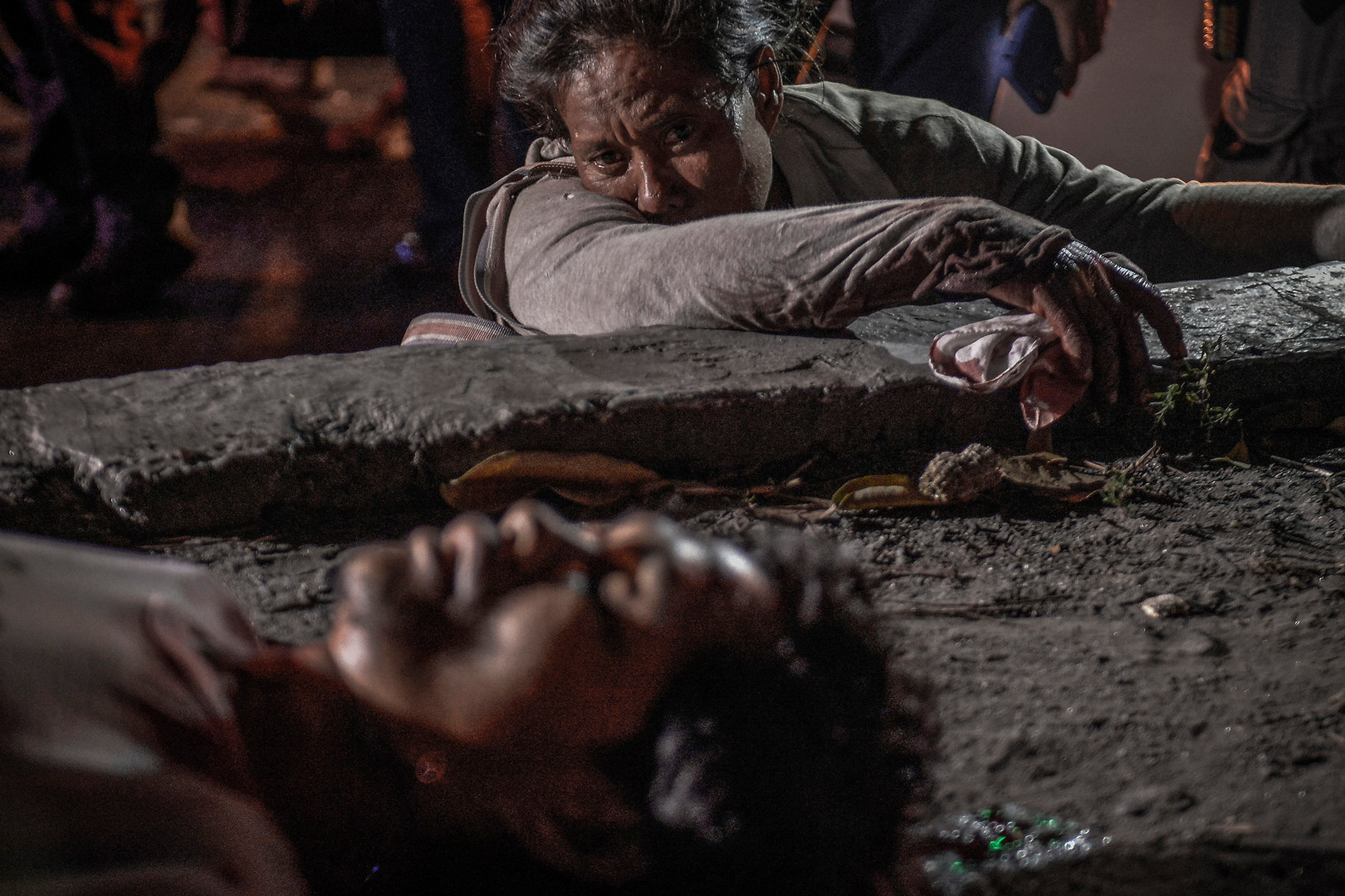 Sentimina Bananga weeps next to the body of her partner Jimmy Said, who according to her was shot dead by an unidentified gunman in a motorcycle while they were begging in the street, in Manila, Philippines, January 22, 2017.