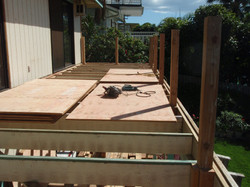 Solid ply wood decking platform going in with 4 x 4 sub postst for the Trex railing