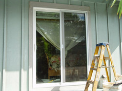 Changed window to new sliding door off master bedroom for access to deck & yard