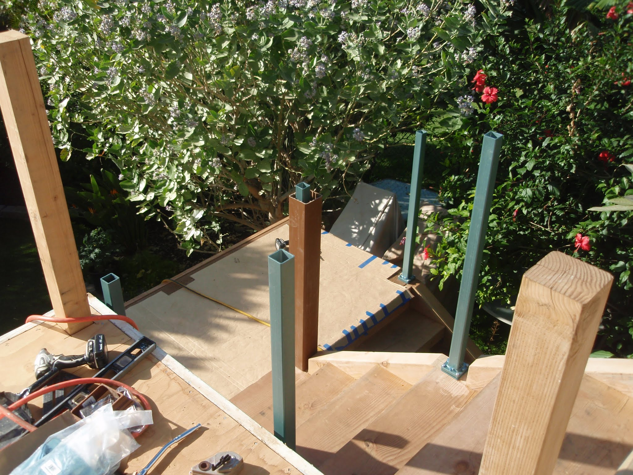 Stair way is utilizing Trex post sleeve railing with metal inner posts securely bolted & balanced in