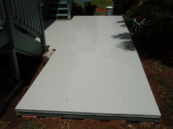 Elastomeric rubber deck coating for entire ground level deck area before color coat