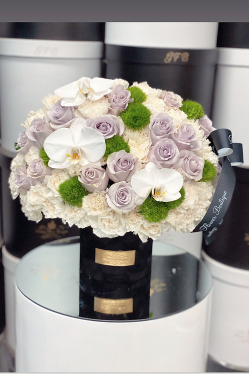 Medium Size flower Arrangement with purple Roses