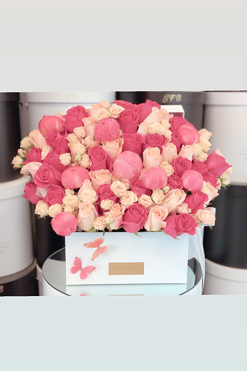 Large Flower Arrangement in Peach and hot pink colors