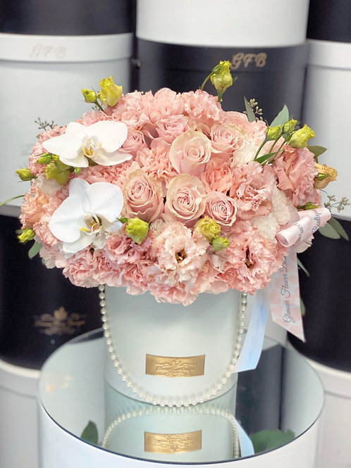 Medium Size Flower Arrangement in Peach Color and White Orchids