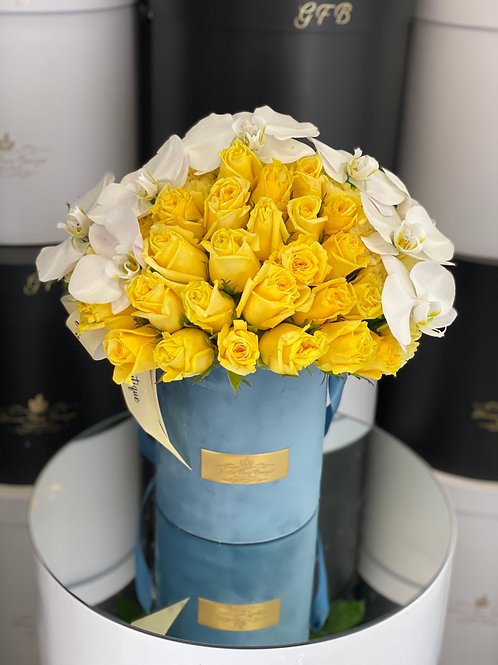 Medium Size Box of Yellow Roses with white orchids