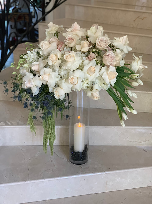 Extra Large Size Flower arrangement with clear cylinder and candle.