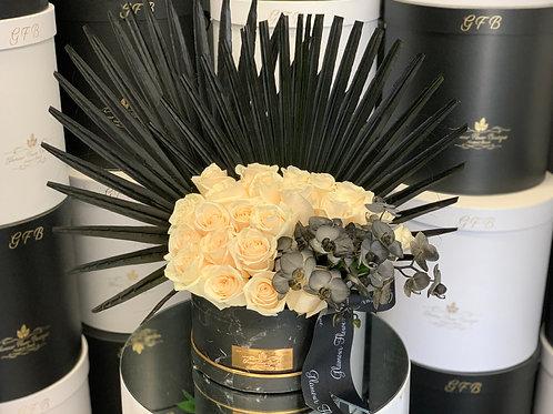 Unique Arrangement with black Orchids