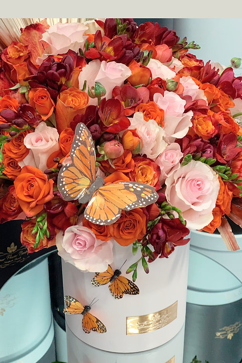 Medium Size Flower Bouquet in color Pink, Orange and Red in light pink box