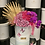 Thumbnail: purple color and hot pink flowers in medium tall box