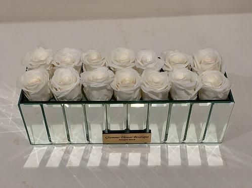 White Preserved Roses In Mirror Vase