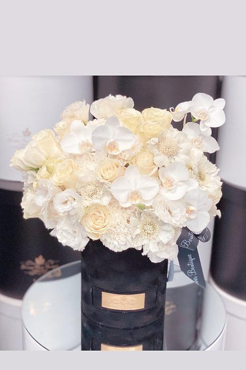 Medium Size Flower Arrangement in color white.