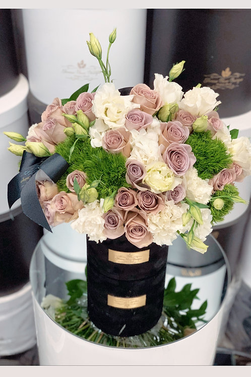 Medium Size Flower Arrangement in color Purple, Green and White