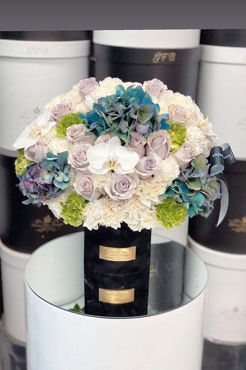 Medium Size Arrangement with purple Roses
