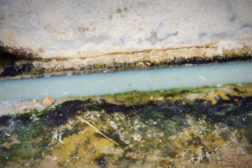 Grey Water By The Side Of Neighbourhood Roads
