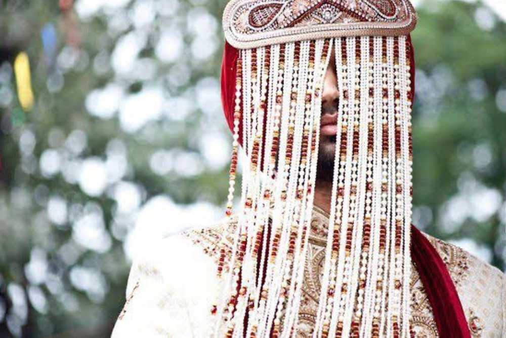 Jag Wearing the Punjabi Groom's Headpiece Known as a Sehra. Photo Credit: JLee Imagery