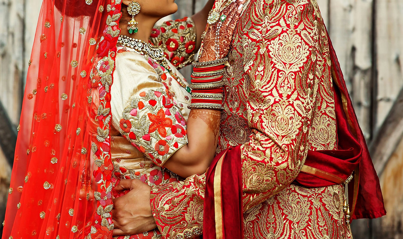 Indian bride and grooms hugging  and sho