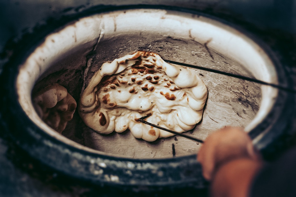 Cooking Roti In A Tandoor Oven