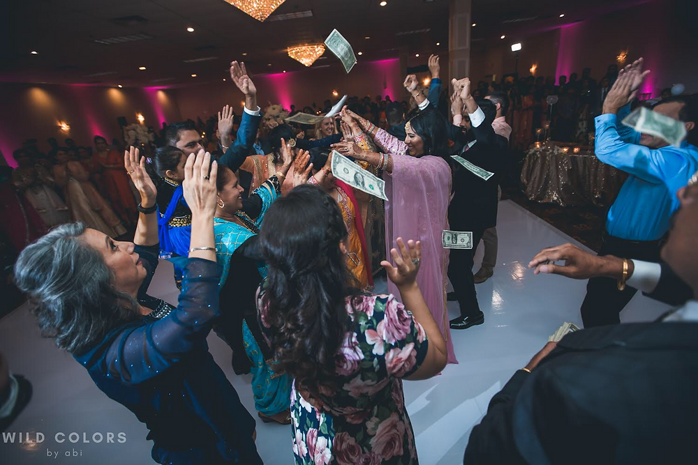A Punjabi Wedding Isn't Complete Without Money Thrown About In The Air