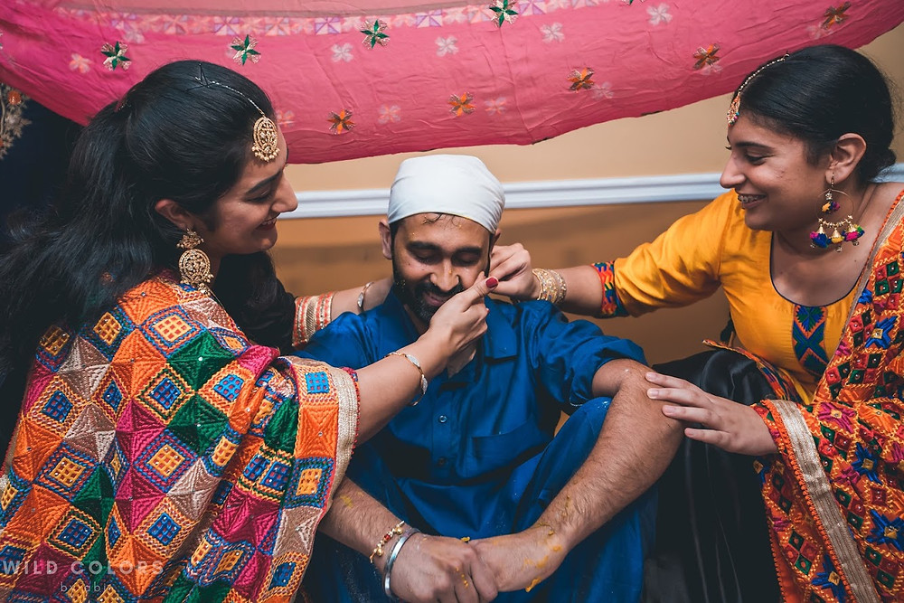 Aunties Applying Tumeric Paste