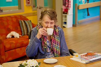 primacare assisted living resident drinking tea