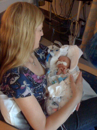 terry call holding baby caiden