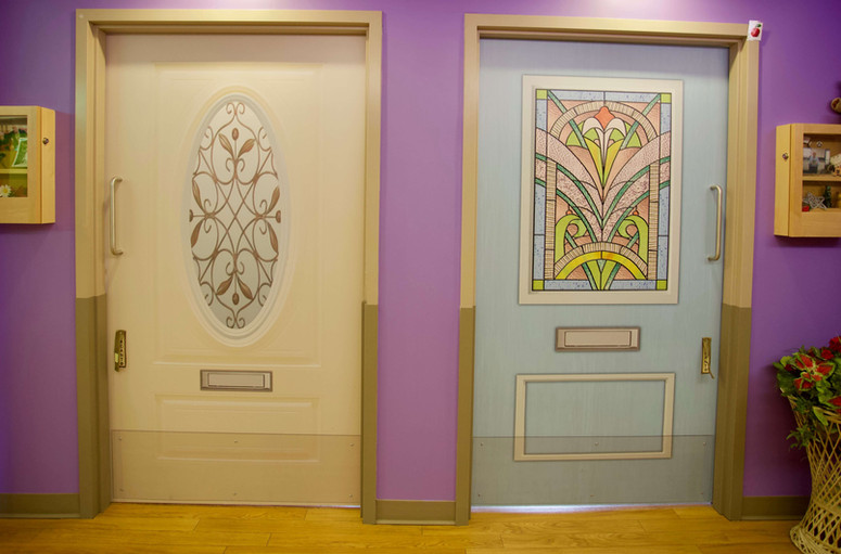 buttefly model of care colorful resident doors