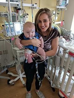 mary sarah holding nicu baby
